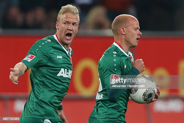 Tobias Werner of Augsburg celebrates scoring the first team goal with his team mate Kevin Vogt during the Bundesliga match between FC Augsburg and...