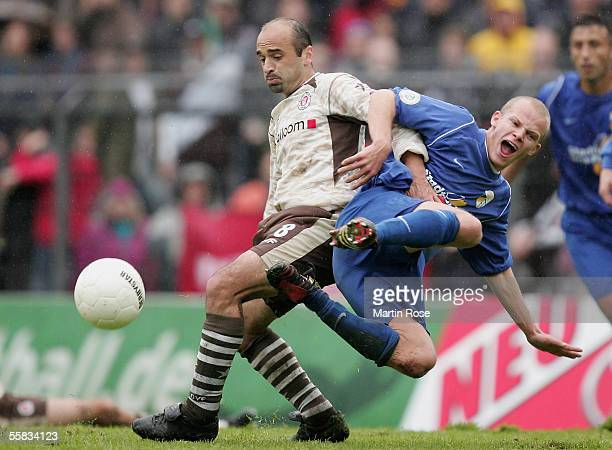 Tobias Werner of Jena challenges Kvicha Shubitidze of StPauli for the ball during the match of the Third Bundesliga between FC St Pauli and Carl...