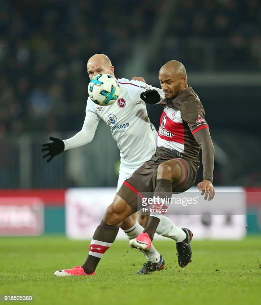 Tobias Werner of Nuernberg and Christopher Avevor of St Pauli battle for the ball during the Second Bundesliga match between FC St Pauli and 1 FC...