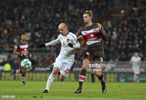 Tobias Werner of Nuernberg and Lasse Sobiech of St Pauli battle for the ball during the Second Bundesliga match between FC St Pauli and 1 FC...