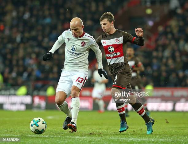 Tobias Werner of Nuernberg and Richard Neudecker of St Pauli battle for the ball during the Second Bundesliga match between FC St Pauli and 1 FC...