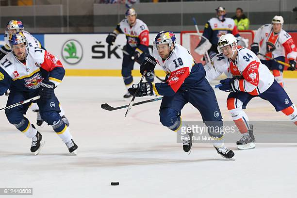 Tobias Woerle of Munich and Olli Palola of Vaxjo during the Champions Hockey League Round of 32 match between Red Bull Munich and Vaxjo Lakers at...