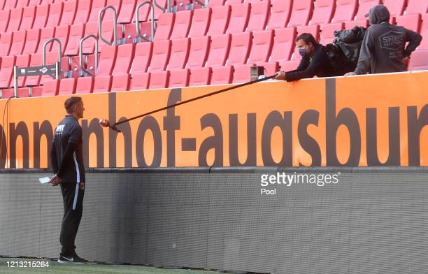 Tobias Zellner, Assistant Head Coach of FC Augsburg is interviewed following the Bundesliga match between FC Augsburg and VfL Wolfsburg at WWK-Arena...