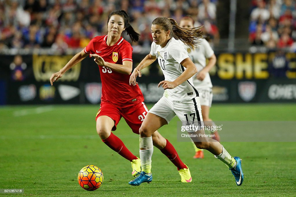 Tobin Health #17 of the United States controls the ball past Yang Man #35 of China during the women's soccer match at University of Phoenix Stadium on December 13, 2015 in Glendale, Arizona.
