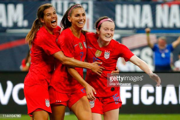 Tobin Heath Alex Morgan and Rose Lavelle celebrates after Lavelle scored a goal against New Zealand at Busch Stadium on May 16 2019 in St Louis...
