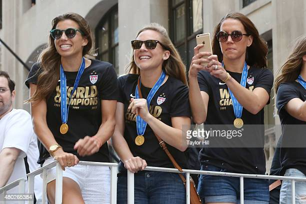 Tobin Heath Amy Rodriguez and Lauren Holiday ride in a tickertape parade commemorating the World Cup victory of the US Women's National Team in the...
