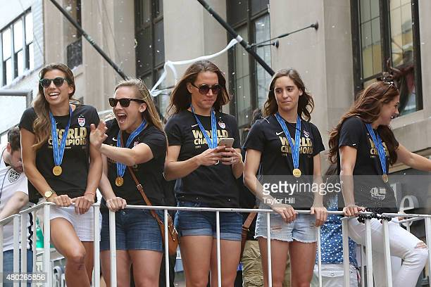 Tobin Heath Amy Rodriguez Lauren Holiday Morgan O'Brien and Alex Morgan ride in a tickertape parade commemorating the World Cup victory of the US...