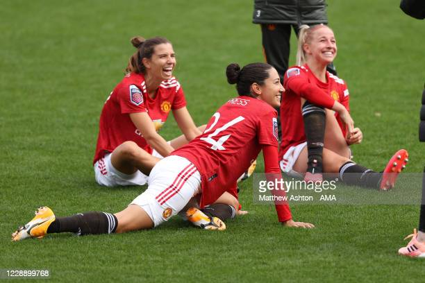Tobin Heath and Christen Press of Manchester United Women warm down after the Barclays FA Women's Super League match between Manchester United and...