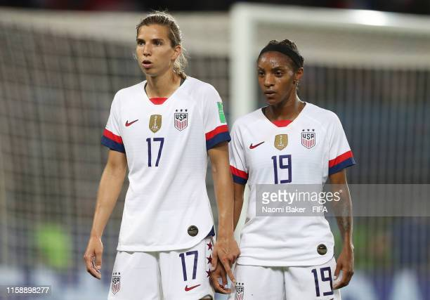 Tobin Heath and Crystal Dunn of the USA look on during the 2019 FIFA Women's World Cup France Quarter Final match between France and USA at Parc des...