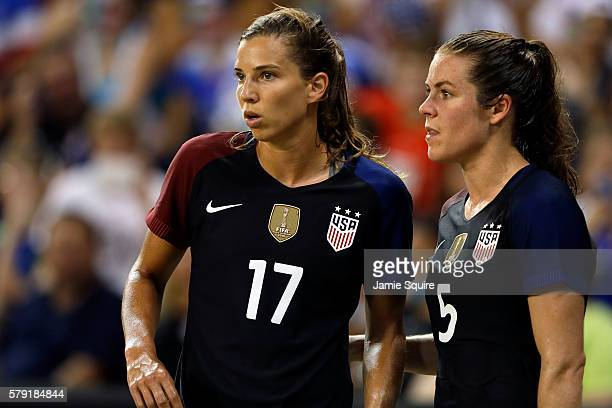 Tobin Heath and Kelley O'Hara of the United States confer during the game against Costa Rica at Children's Mercy Park on July 22 2016 in Kansas City...