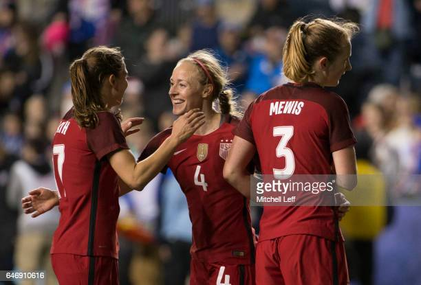 Tobin Heath Becky Sauerbrunn and Samantha Mewis of United States of America celebrate at the end of the match against Germany during the SheBelieves...