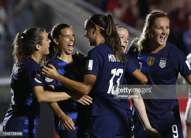 Tobin Heath celebrates with teammate Alex Morgan of USA after scoring a goal against Mexico during the Group A CONCACAF Women's Championship at...