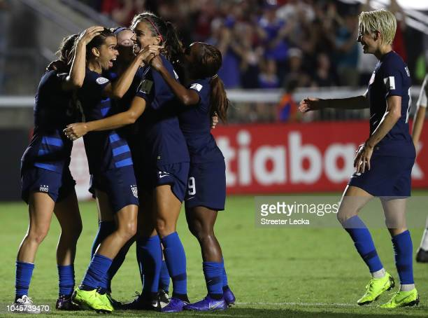Tobin Heath celebrates with teammates Alex Morgan and Megan Rapinoe of USA after scoring a goal against Mexico during the Group A CONCACAF Women's...