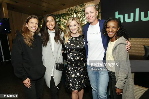 Tobin Heath Christen Press Reese Witherspoon Abby Wambach and Crystal Dunn pose for a photo during the Hulu '19 Presentation at Hulu Theater at MSG...