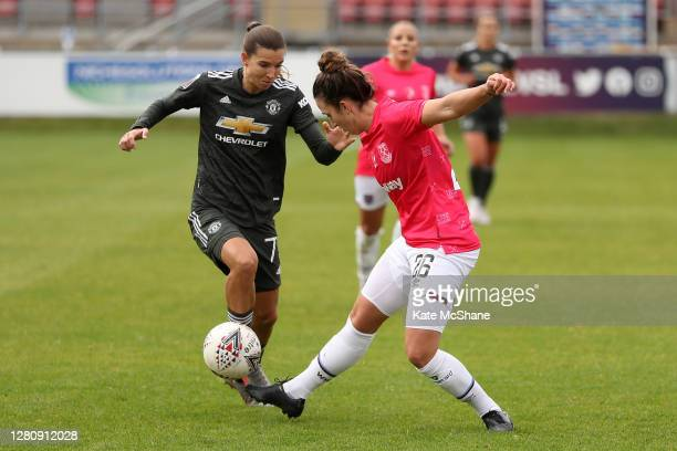 Tobin Heath of Manchester United and Laura Vetterlein of West Ham United battle for the ball during the Barclays FA Women's Super League match...