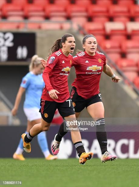 Tobin Heath of Manchester United celebrates after scoring her team's first goal during the Barclays FA Women's Super League match between Manchester...
