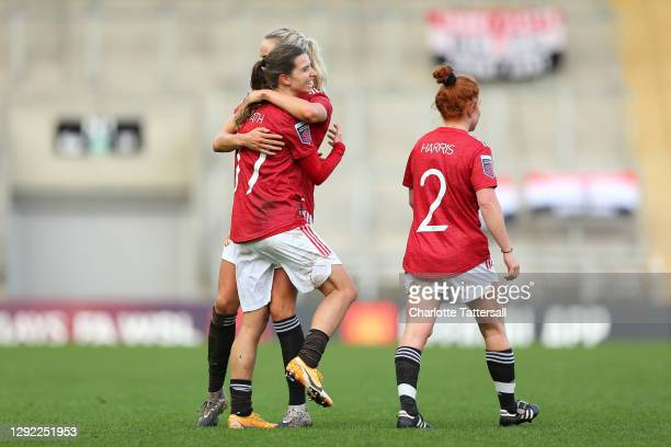 Tobin Heath of Manchester United celebrates with team mate Millie Turner after scoring their sides sixth goal during the Barclays FA Women's Super...