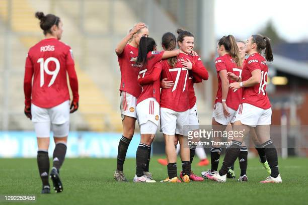 Tobin Heath of Manchester United celebrates with team mates after scoring their sides ffifth goal during the Barclays FA Women's Super League match...