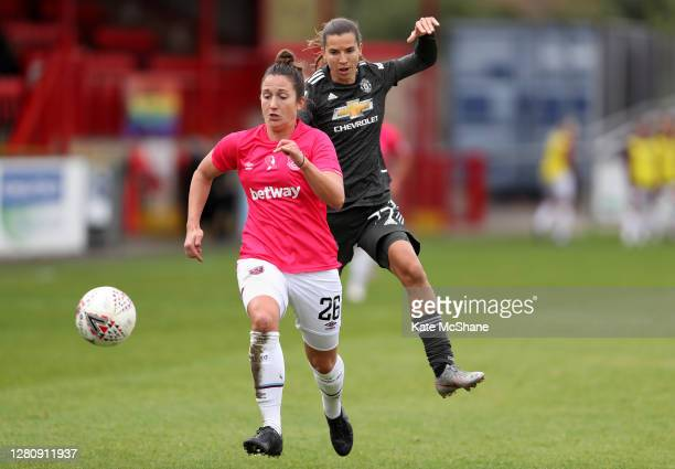 Tobin Heath of Manchester United chases down Laura Vetterlein of West Ham United during the Barclays FA Women's Super League match between West Ham...