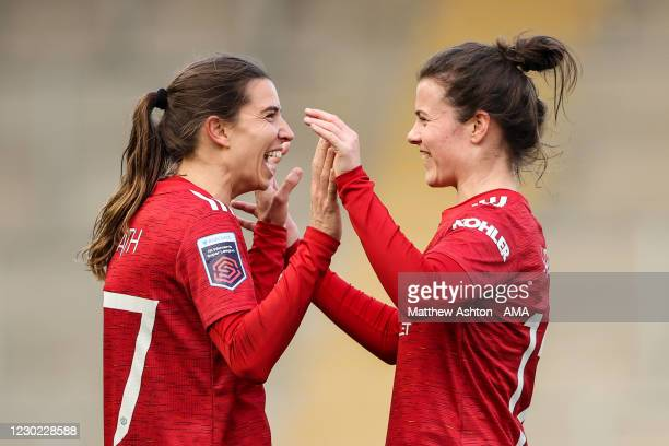 Tobin Heath of Manchester United Women celebrates with team mates after scoring a goal to make it 6-1 during the Barclays FA Women's Super League...