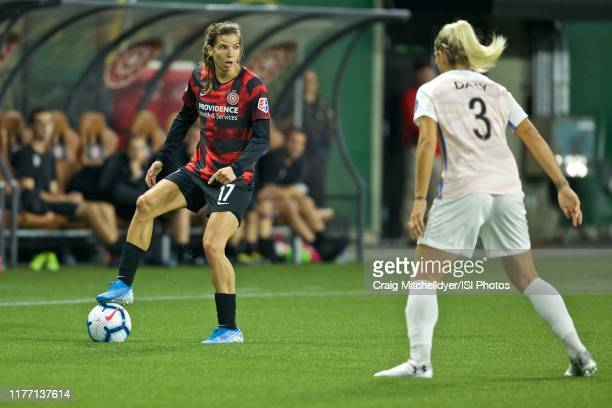 Tobin Heath of the Portland Thorns FC spins away from Rachel Daly of the Houston Dash during a game between the Houston Dash and the Portland Thorns...