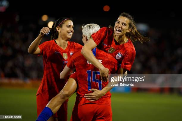 Tobin Heath of the United States celebrates with Alex Morgan and Megan Rapinoe after scoring a goal against Australia during the second half of an...
