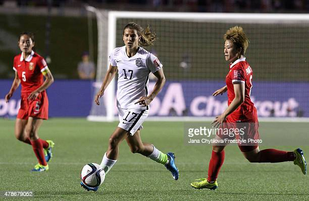 Tobin Heath of the United States controls the ball against Pang Fengyue of China in the second half in the FIFA Women's World Cup 2015 Quarter Final...