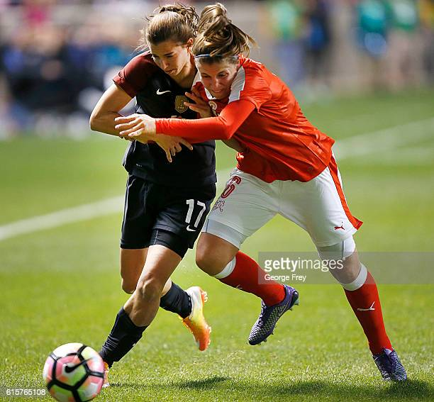 Tobin Heath of the United States fights for the ball with Selina Kuster of Switzerland during an international friendly match at Rio Tinto Stadium on...