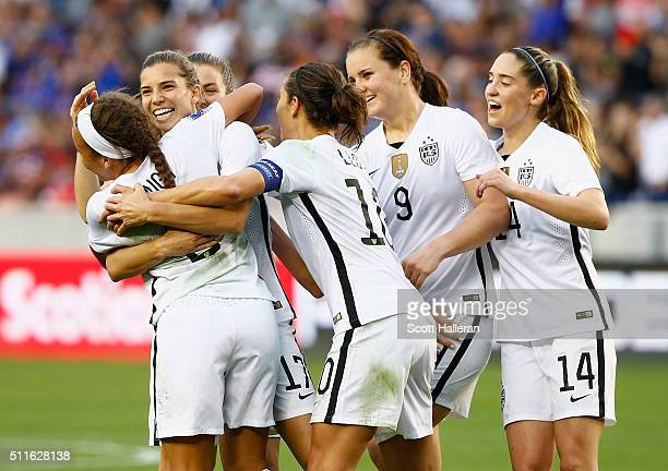 Tobin Heath of the United States gets mobbed by her teammates after Heath scored a second half goal against Canada during the Championship final of...