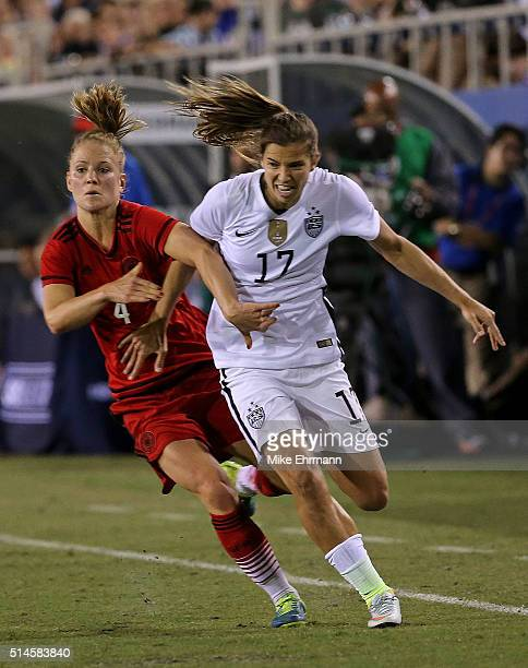 Tobin Heath of the United States is tripped by Leonie Maier of Germany during a match in the 2016 SheBelieves Cup at FAU Stadium on March 9 2016 in...