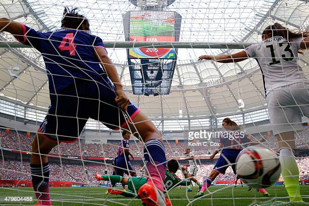 Tobin Heath of the United States scores on a shot past Ayumi Kaihori of Japan in the second half in the FIFA Women's World Cup Canada 2015 Final at...