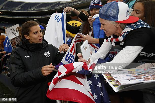 Tobin Heath of the United States signs autographs for fans after the United States defeated Ireland 50 at Qualcomm Stadium on January 23 2016 in San...