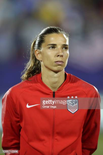 Tobin Heath of the United States stands during the National Anthem before the semifinals match between Jamaica and United States as part of CONCACAF...