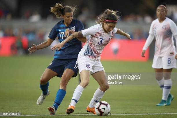 Tobin Heath of the United States tries to get the ball from Carla Guerrero of Chile during their match at Avaya Stadium on September 4 2018 in San...