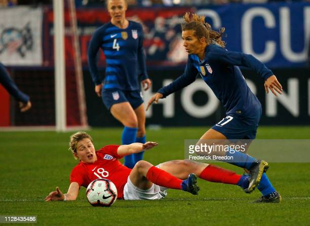 Tobin Heath of the USA carries the ball past fallen Ellen White of England during the second half of the 2019 SheBelieves Cup match between USA and...