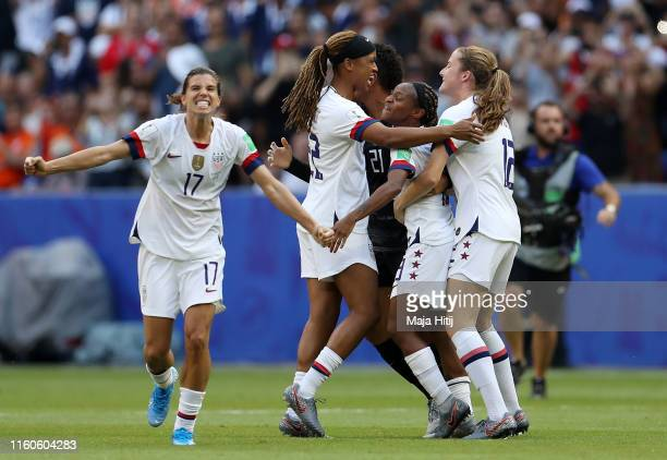 Tobin Heath of the USA celebrates with teammates following the 2019 FIFA Women's World Cup France Final match between The United States of America...