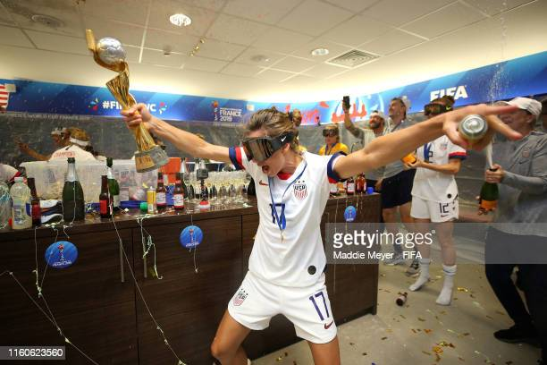 Tobin Heath of the USA celebrates with the FIFA Women's World Cup Trophy in the dressing room following her team's victory in the 2019 FIFA Women's...