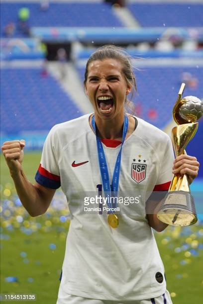 Tobin Heath of the USA celebrating with the trophy after their victory during the 2019 FIFA Women's World Cup France Final match between The United...