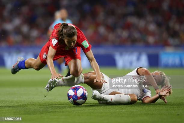 Tobin Heath of the USA is challenged by Rachel Daly of England during the 2019 FIFA Women's World Cup France Semi Final match between England and USA...