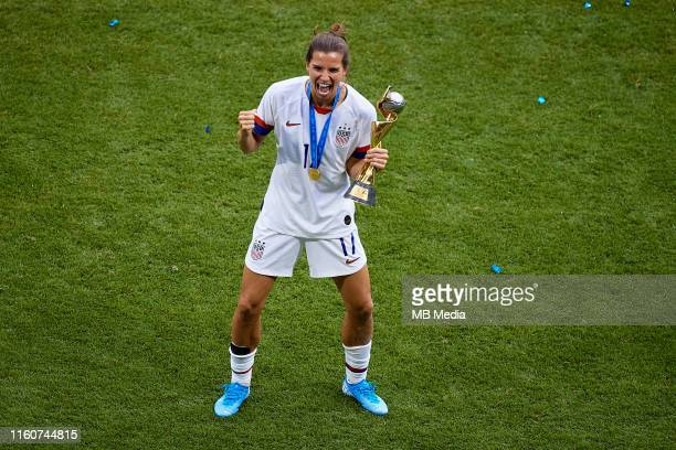 Tobin Heath of the USA poses with the FIFA World Cup trophy during the 2019 FIFA Women's World Cup France Final match between The United States of...
