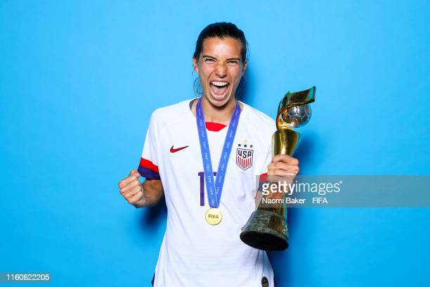 Tobin Heath of the USA poses with the Women's World Cup trophy after the 2019 FIFA Women's World Cup France Final match between The United State of...
