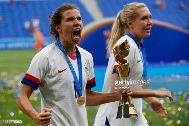 Tobin Heath of United States and Allie Long of United States pose whit the trophy after win 2019 FIFA Women's World Cup France Final match between...