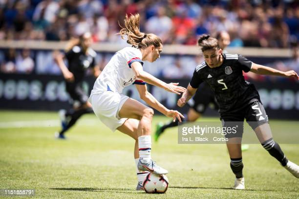 Tobin Heath of United States drives to the goal against Jimena López of Mexico during the International Friendly match the US Women's National Team...