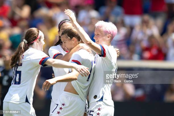 Tobin Heath of United States gets congratulated by teammates Captain Alex Morgan of United States and Megan Rapinoe of United States during the 1st...