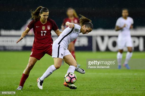 Tobin Heath of United States of America and Eve Perisset of France go after the ball in the first half during the 2017 SheBelieves Cup at RFK Stadium...