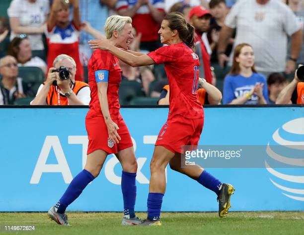 Tobin Heath of Unites States celebrates her goal with teammate Megan Rapinoe in the first half against New Zealand at Busch Stadium on May 16 2019 in...