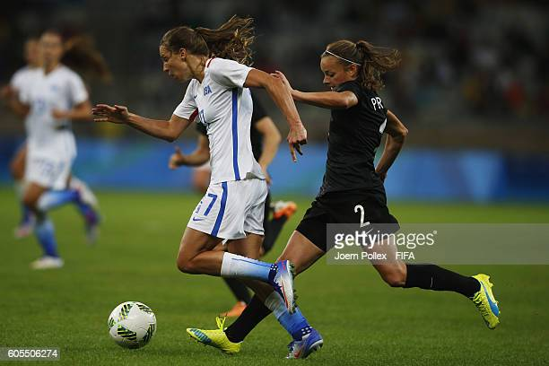 Tobin Heath of USA and Ria Percival of New Zealand compete for the ball during Women's Group G match between USA and New Zealand on Day 2 of the...
