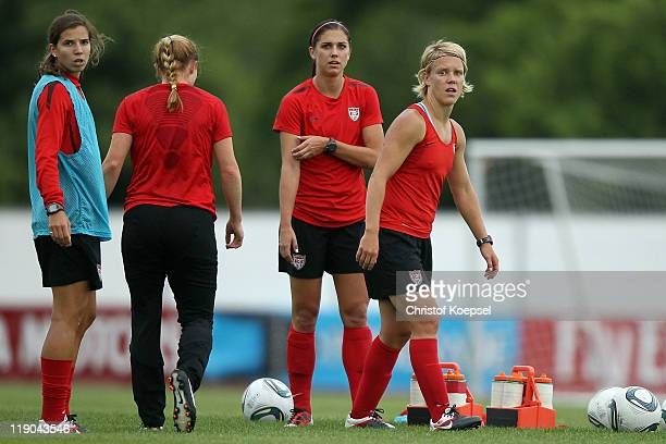 Tobin Heath Rachel Buehler Alex Morgan and Lori Lindsey of USA attend the USA team training session at training ground Rebstock on July 14 2011 in...