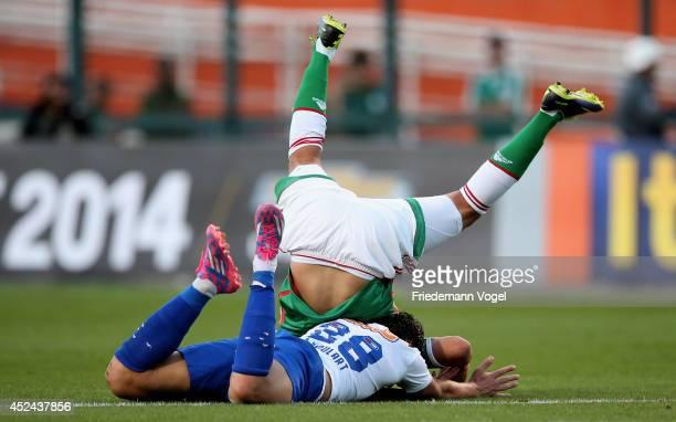 Tobio of Palmeiras fights for the ball with Ricardo Goulart of Cruzeiro during the match between Palmeiras and Cruzeiro for the Brazilian Series A...