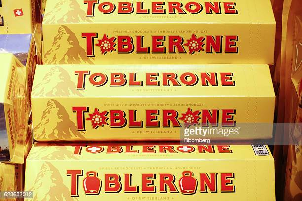 Toblerone chocolate bars manufactured by Mondelez International Inc sit on display inside a retailer in Lugano Switzerland on Tuesday Nov 15 2016...